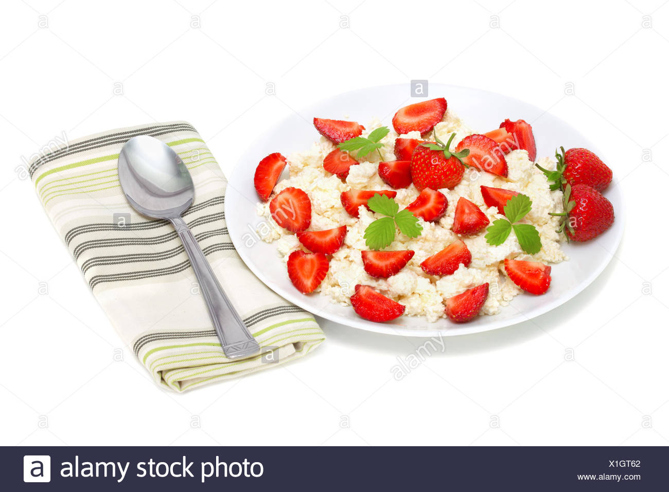 cottage cheese with strawberries isolated on white - Stock Image