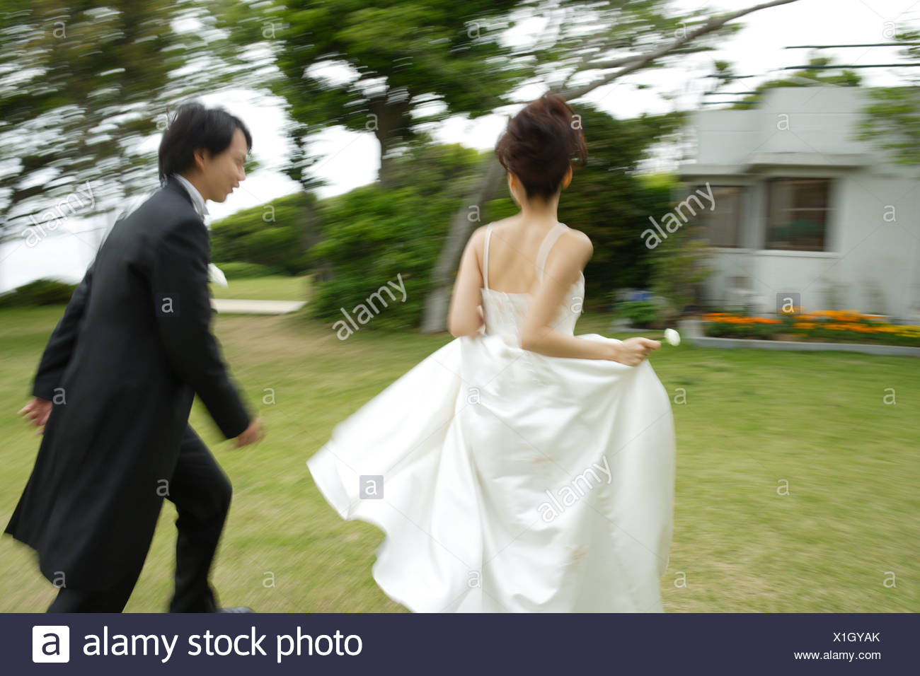 Wondrous Bride And Groom Running On Lawn Blurred Motion Stock Photo Download Free Architecture Designs Scobabritishbridgeorg