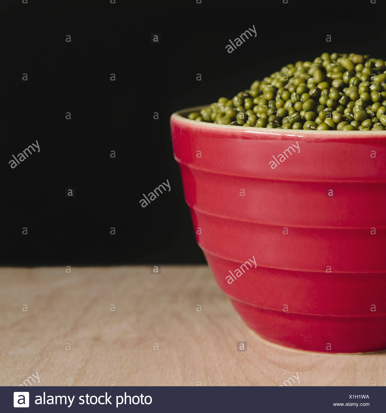 Bowl of mung beans (a legume also know as green gram or golden gram) - Stock Image