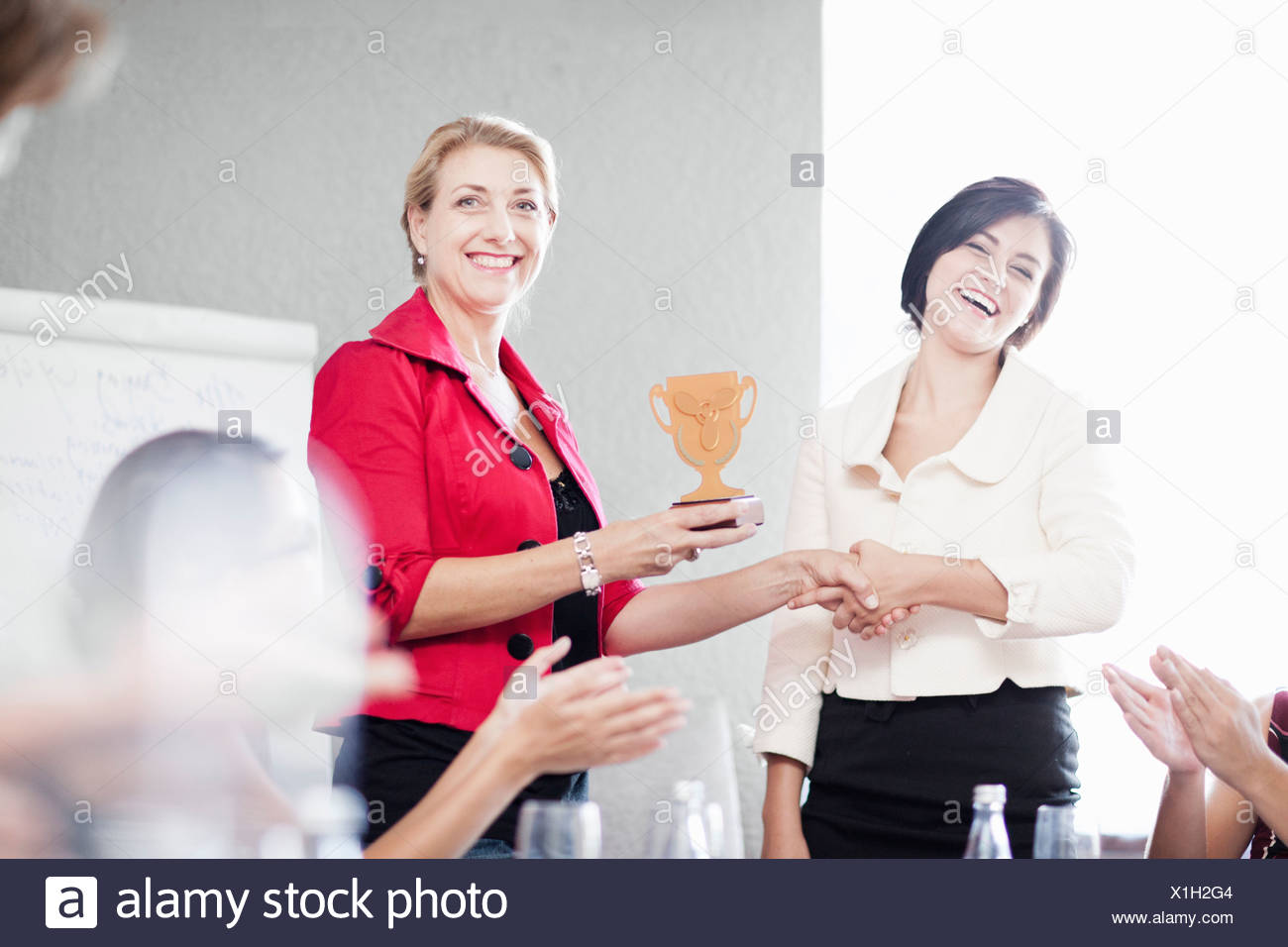 Businesswoman receiving award - Stock Image