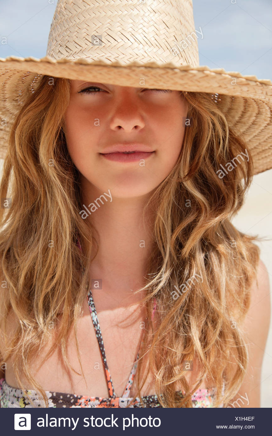pretty women in straw hat in the sun stock photo: 276357271 - alamy