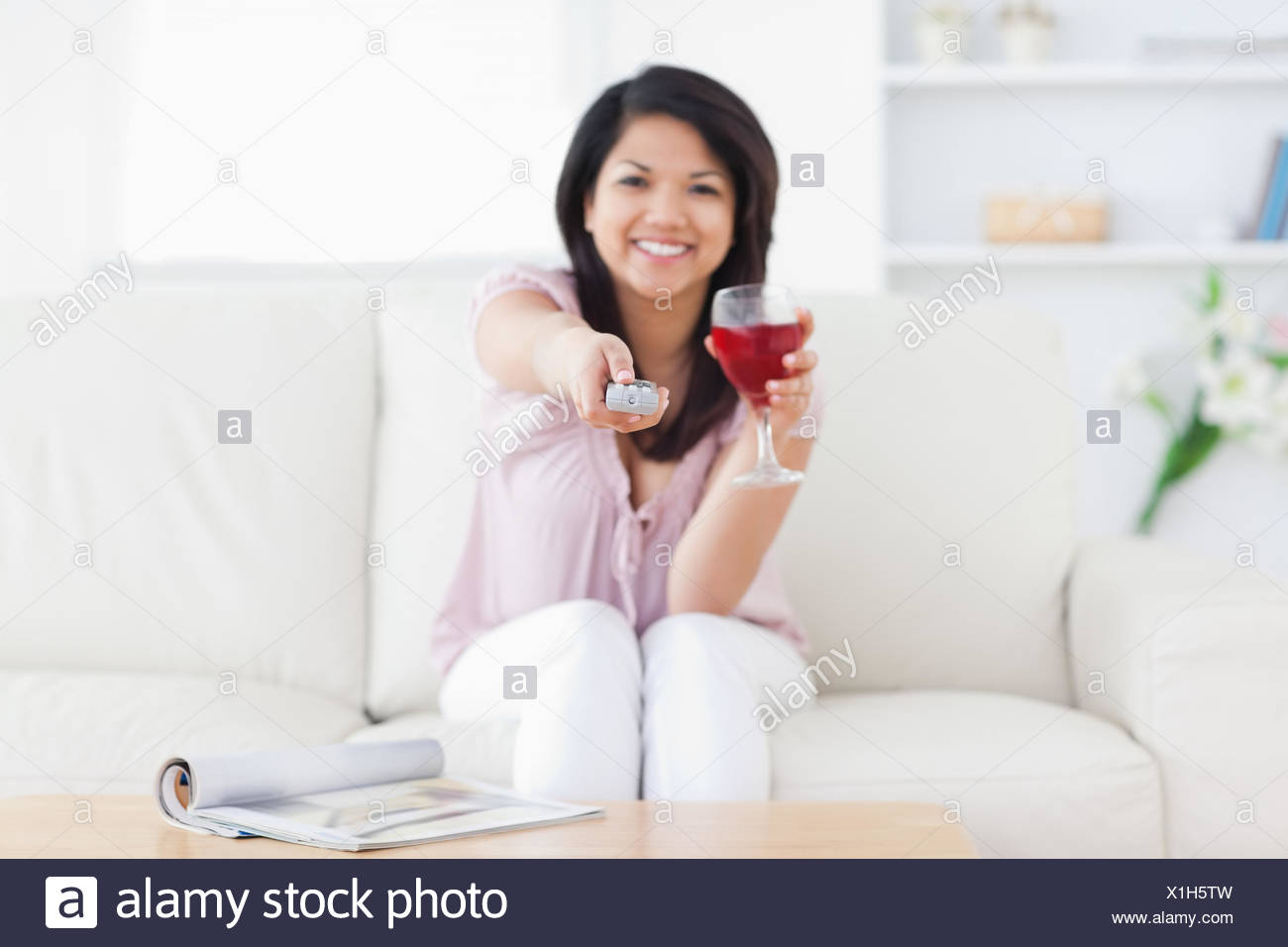 Magnificent Woman Sitting In A White Couch While Holding A Glass Of Red Inzonedesignstudio Interior Chair Design Inzonedesignstudiocom