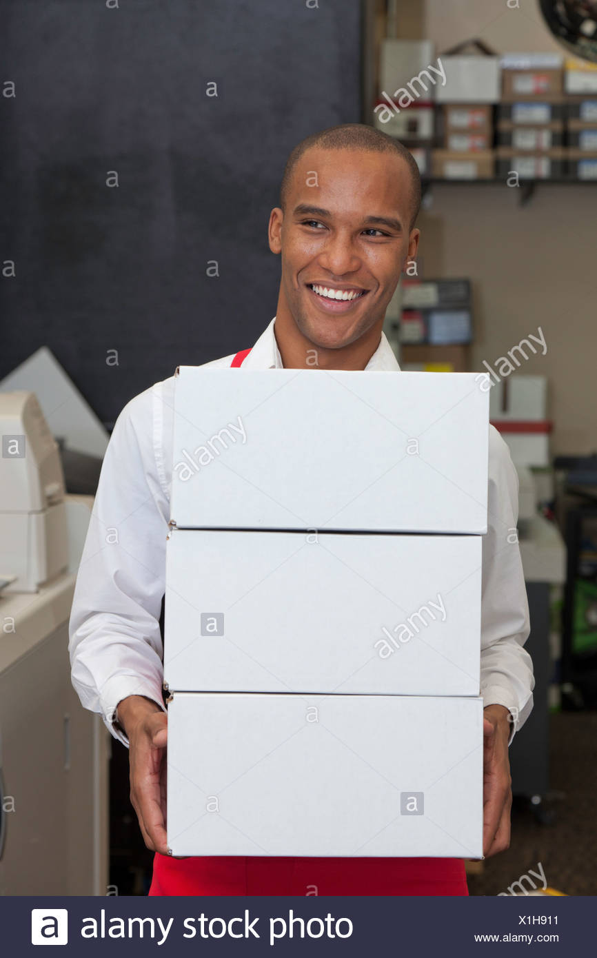 Cheerful worker holding containers - Stock Image
