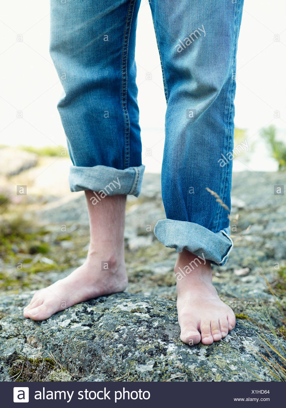 Barefooted man Sweden. - Stock Image