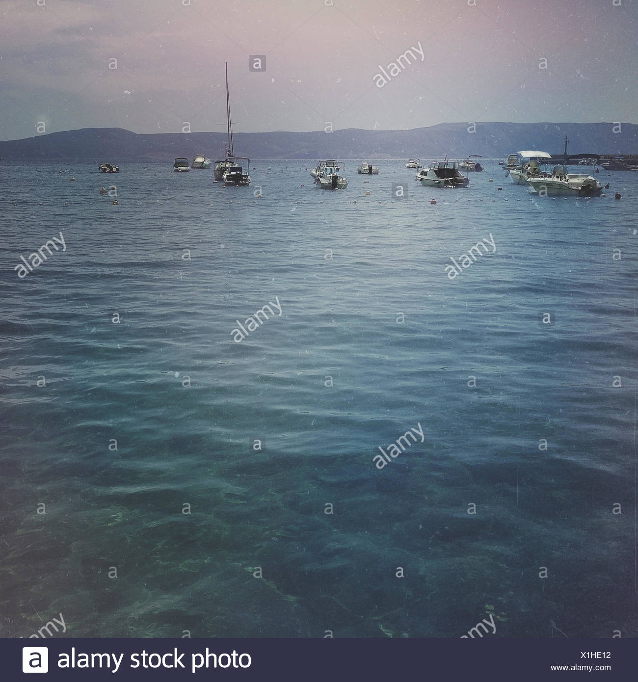 Boats anchored at sea Stock Photo