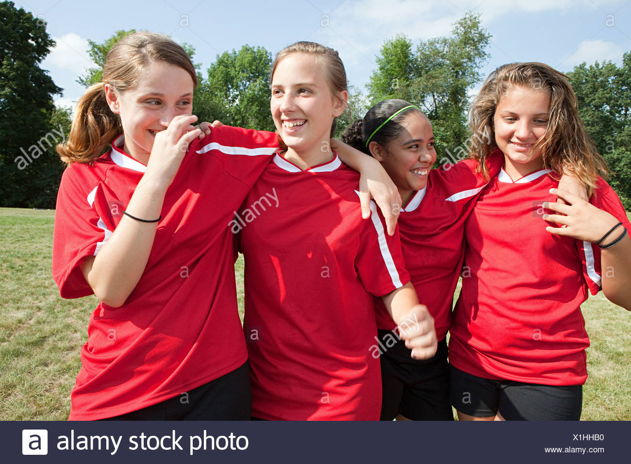 Girl soccer players laughing - Stock Image