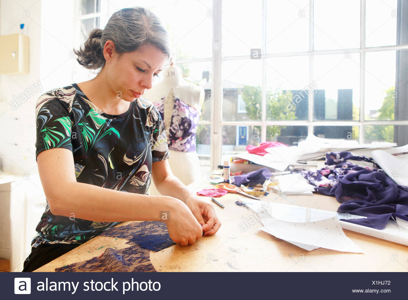 Designer at work in studio - Stock Image