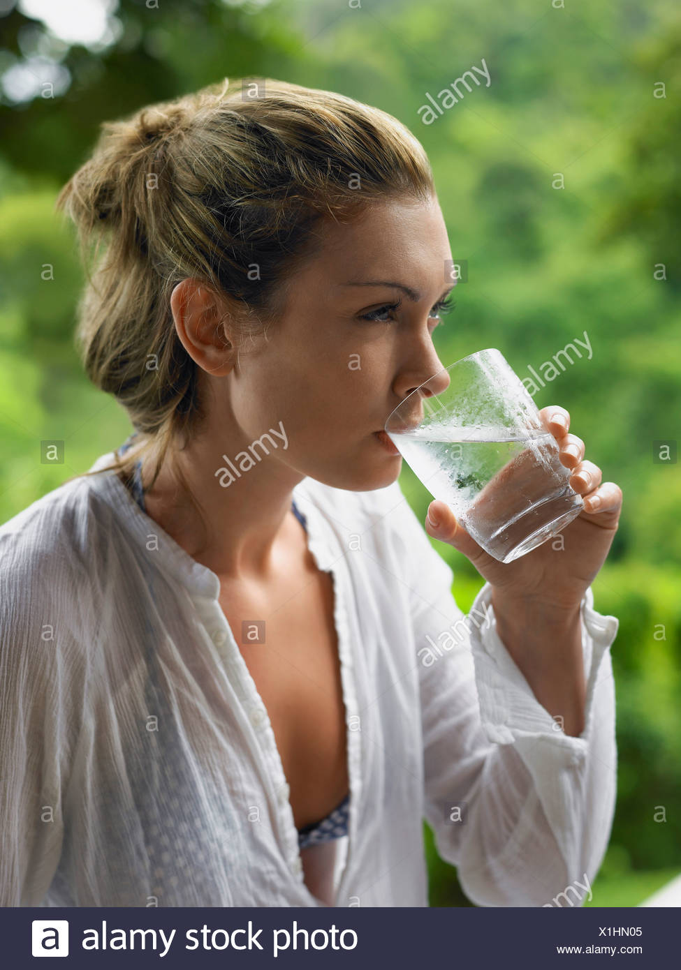 Young Woman Drinking Water - Stock Image