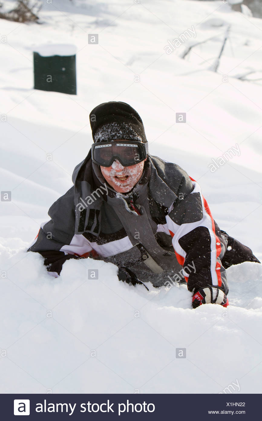 Skier, without a helmet, after a fall - Stock Image