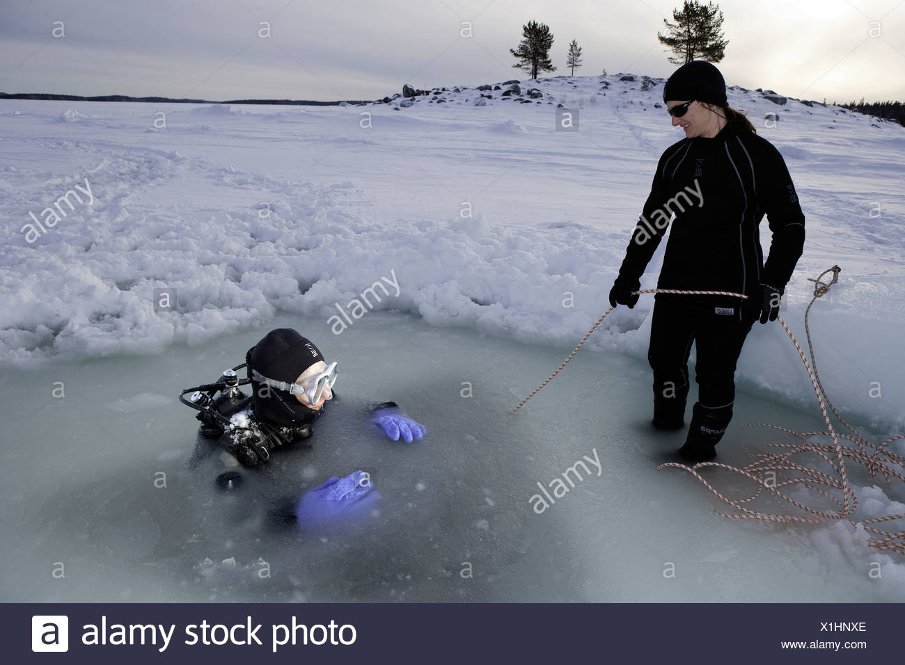 Ice Diving safeguarding with Safety Rope, White Sea, Karelia, Russia - Stock Image
