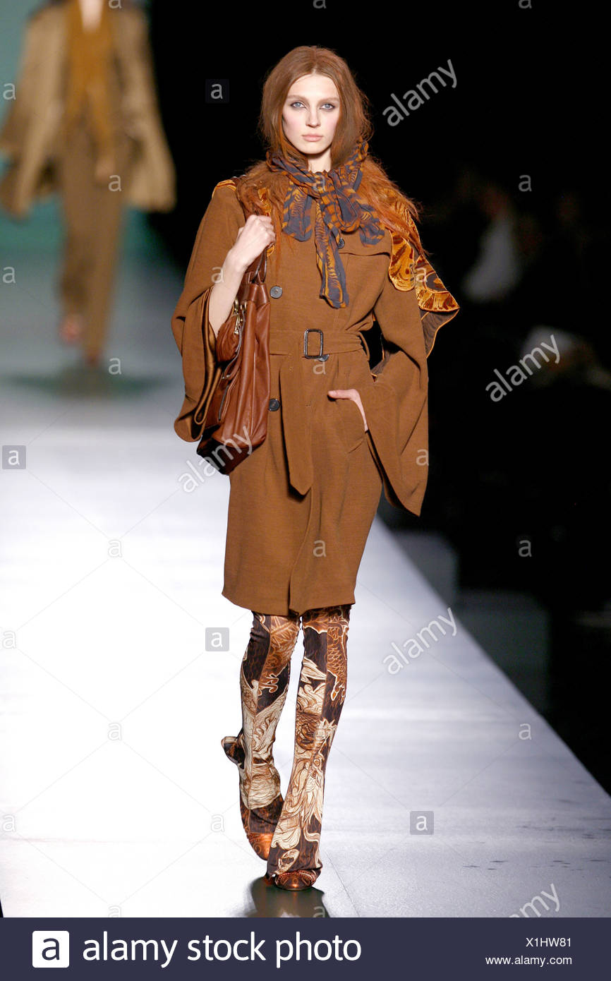 aa928aa5026 Jean Paul Gaultier Paris Ready to Wear Autumn Winter Model wearing terracotta  double breasted coat