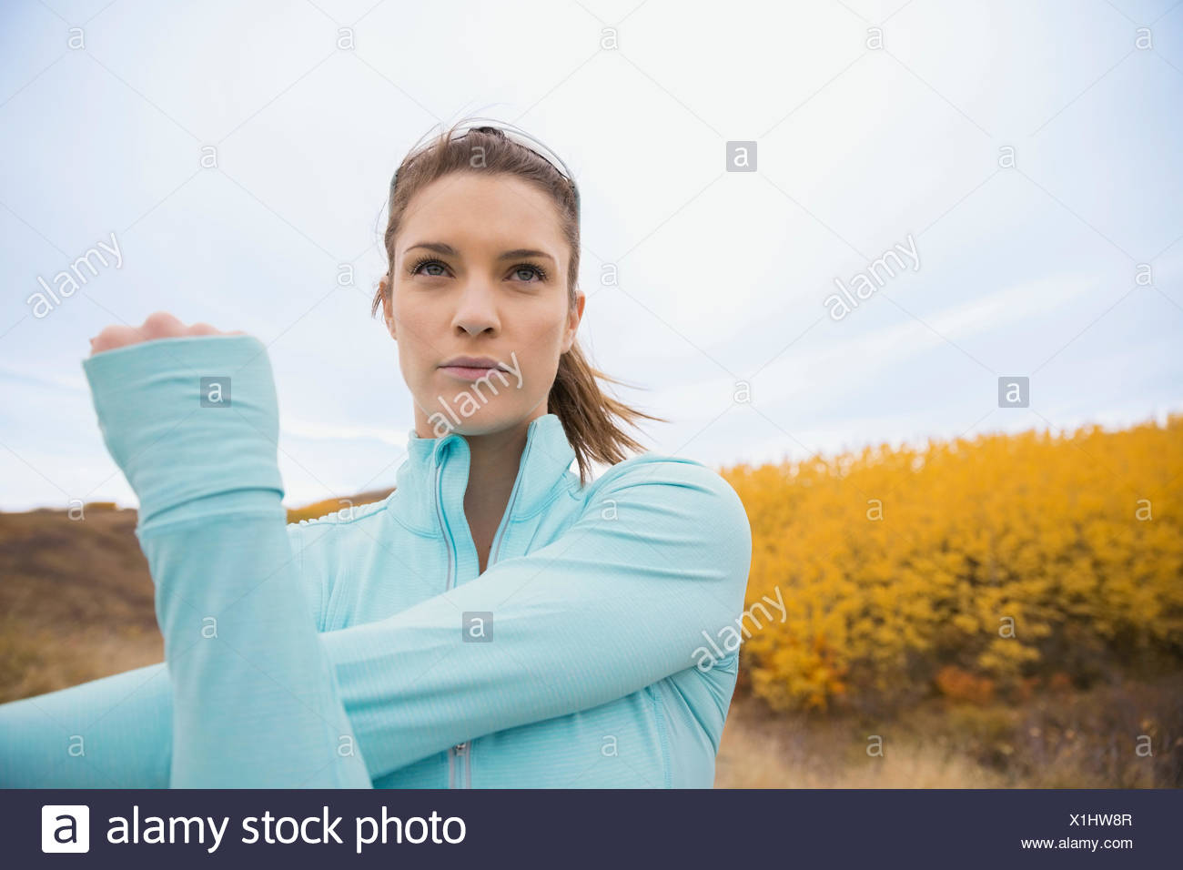 Runner stretching arm - Stock Image