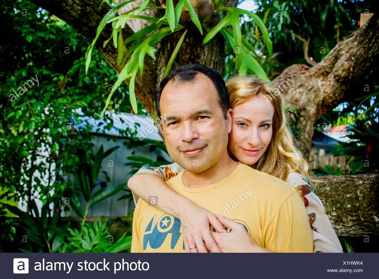 Portrait of mature couple in garden Stock Photo