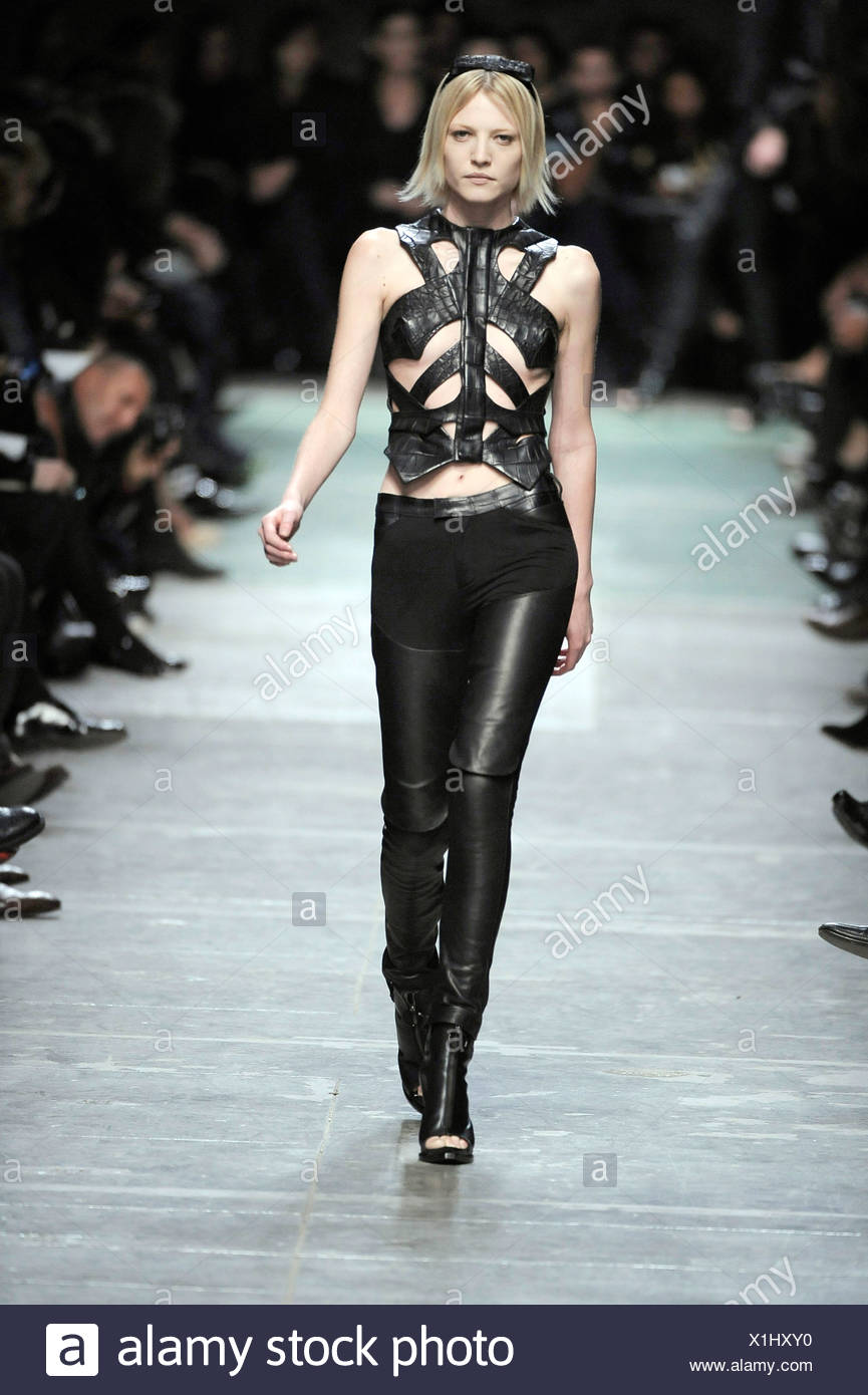 76f082972038 Givenchy Paris Ready to Wear Spring Summer Model wearing black leather  chaps style tight trousers