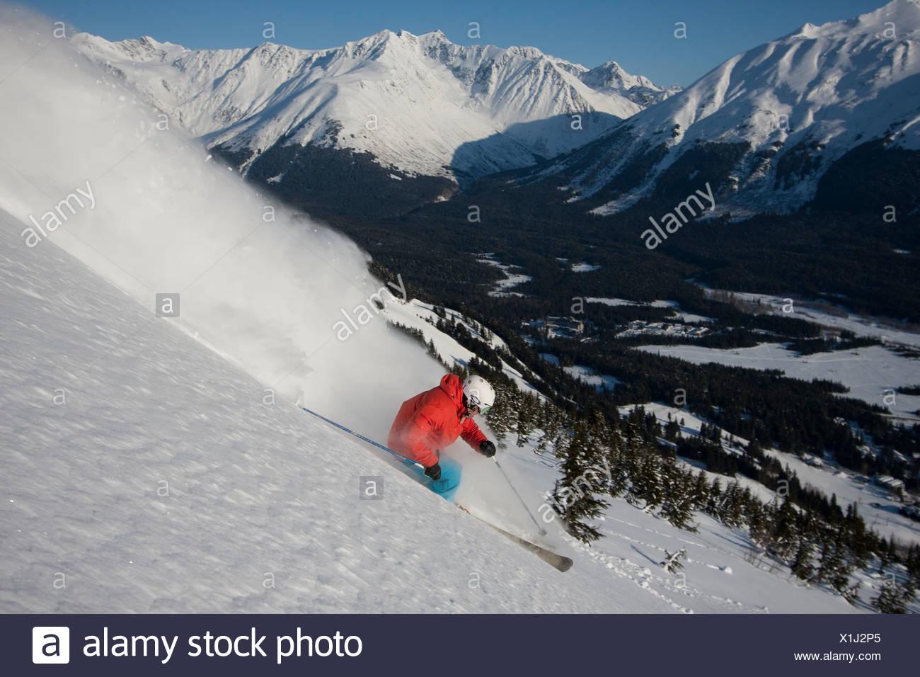 Downhill skier in the backcountry of Alyeska Resort, Southcentral Alaska, Winter - Stock Image