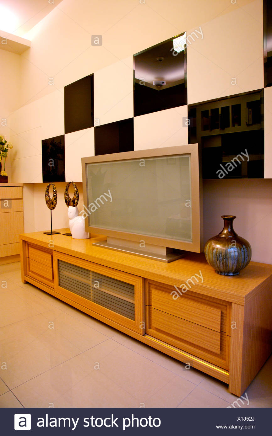 modern style living room with flat screen on side cabinet stock