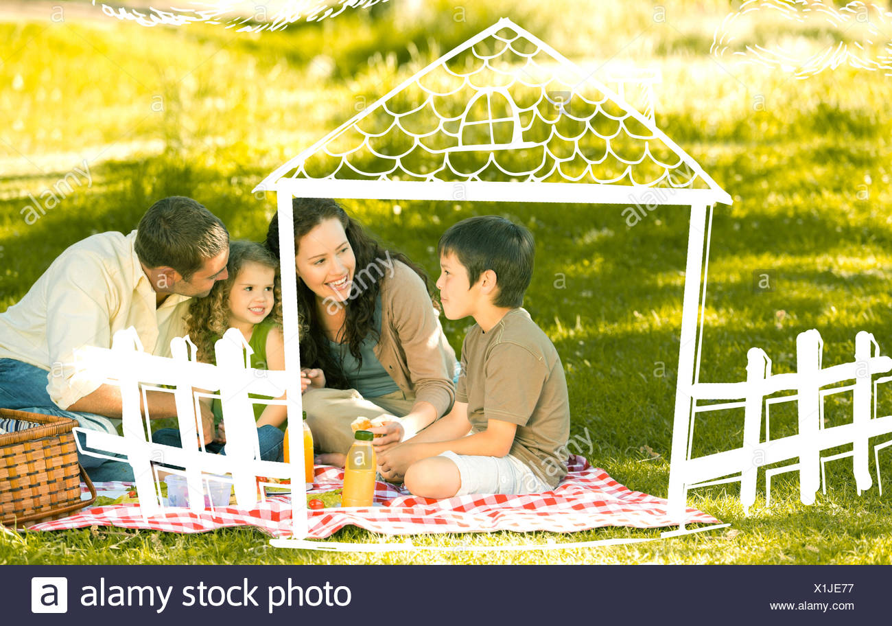 Composite image of family picnicking together - Stock Image