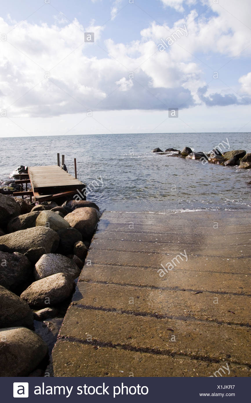 Germany, Fehmarn, jetty on waterfront - Stock Image