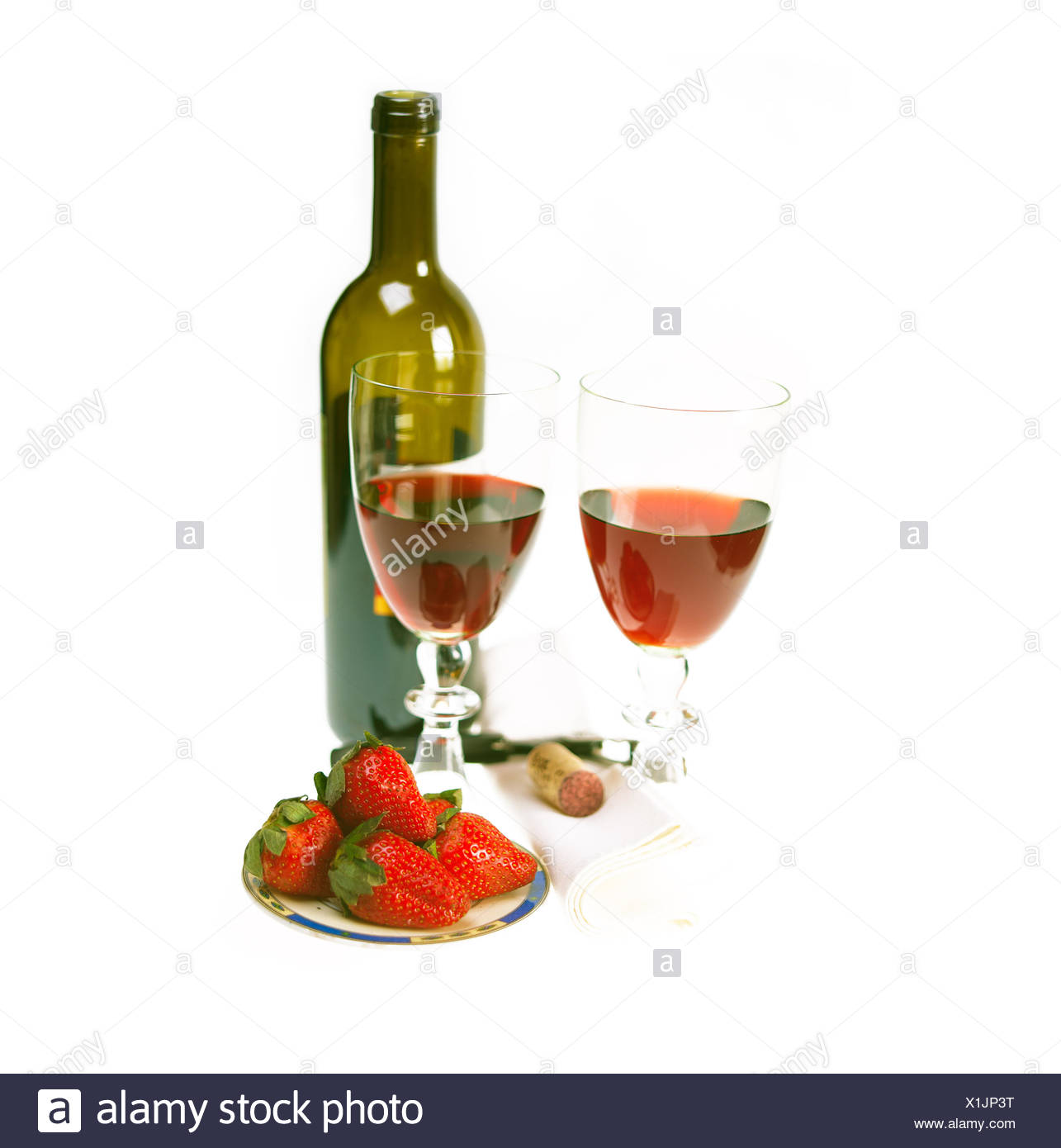 red wine bottle and two glasses with