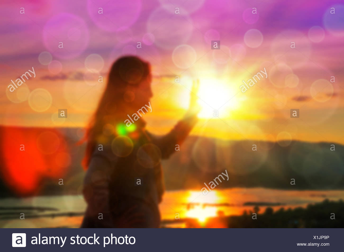 Abstract Blurred and soft photo of Women on hilltop Stock Photo
