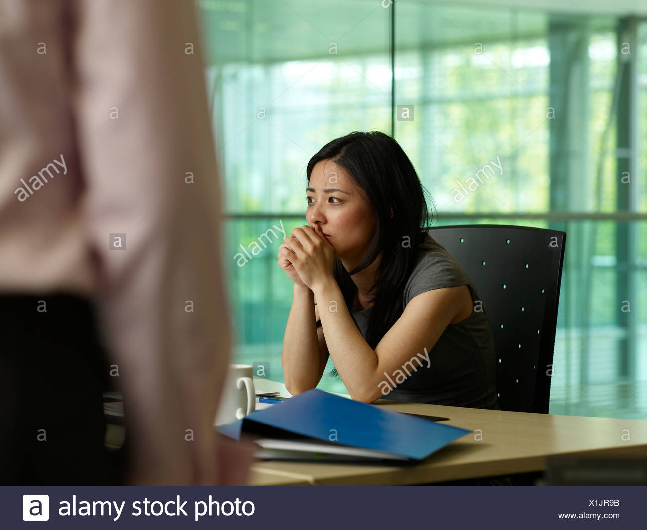 A woman looks at a crying girl Stock Photo