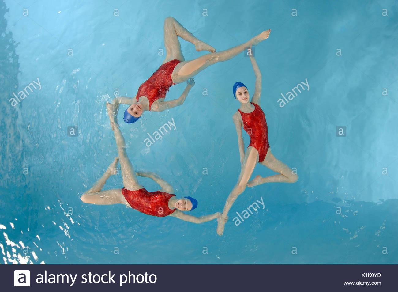 Synchronized swim team performing - Stock Image