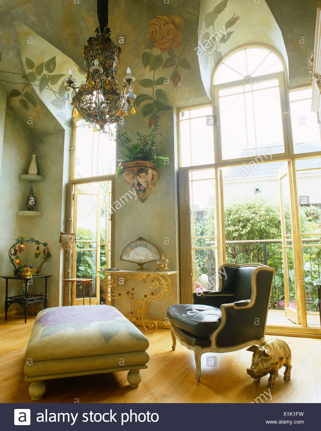 French Style Armchair And Ottoman In Living Room With High, Rose Painted  Ceiling And French Windows