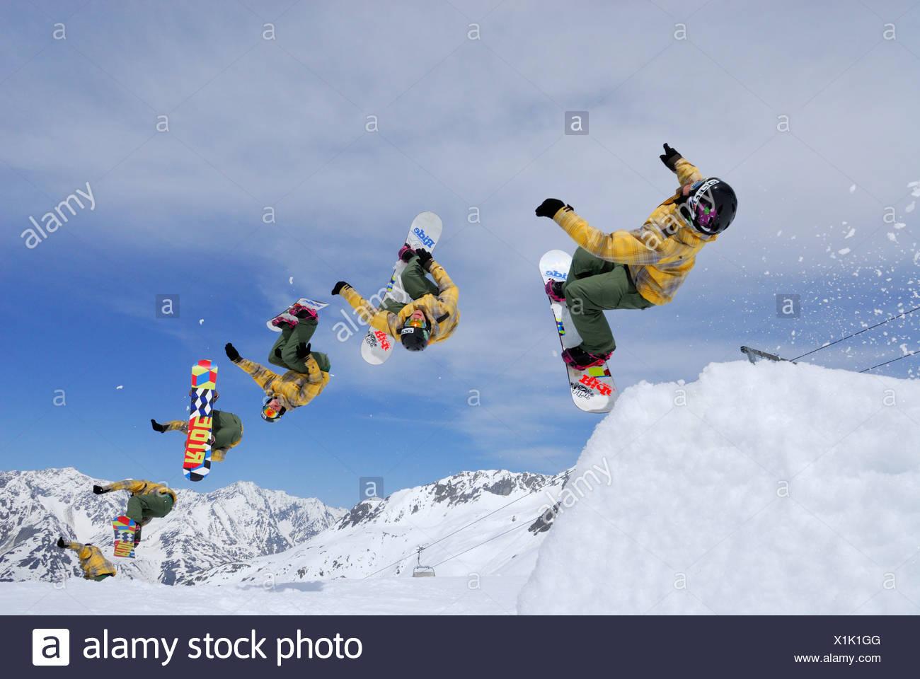 Snowboarder in mid-air, back-flip, multiple image, ski area Soelden, Oetztal, Tyrol, Austria - Stock Image