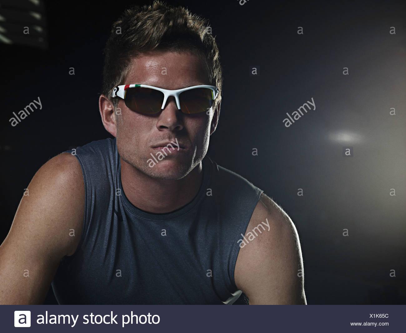 Runner in sunglasses at starting line Stock Photo