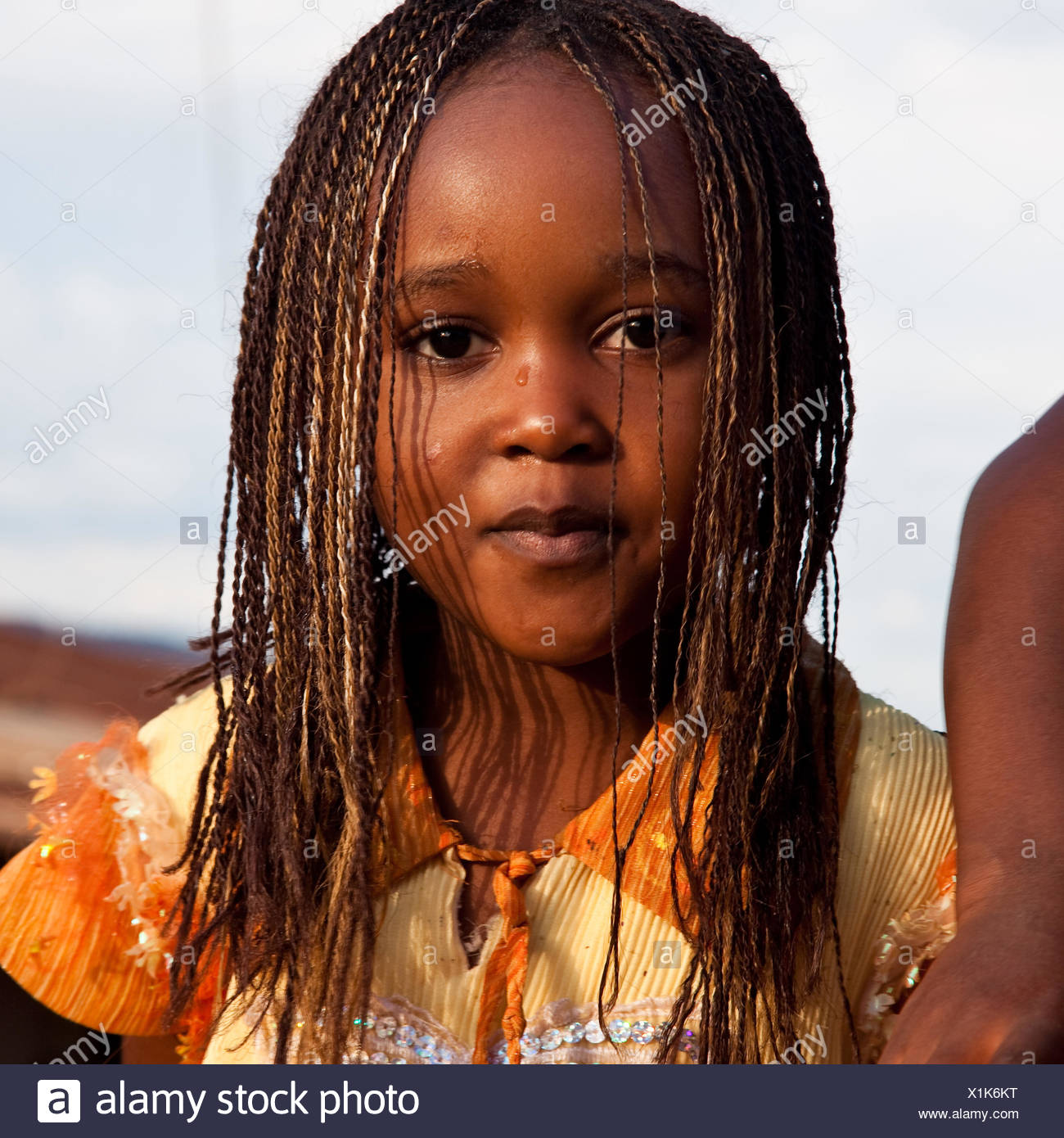 young girl with breaded hair, Rwanda, Nyamirambo, Kigali - Stock Image