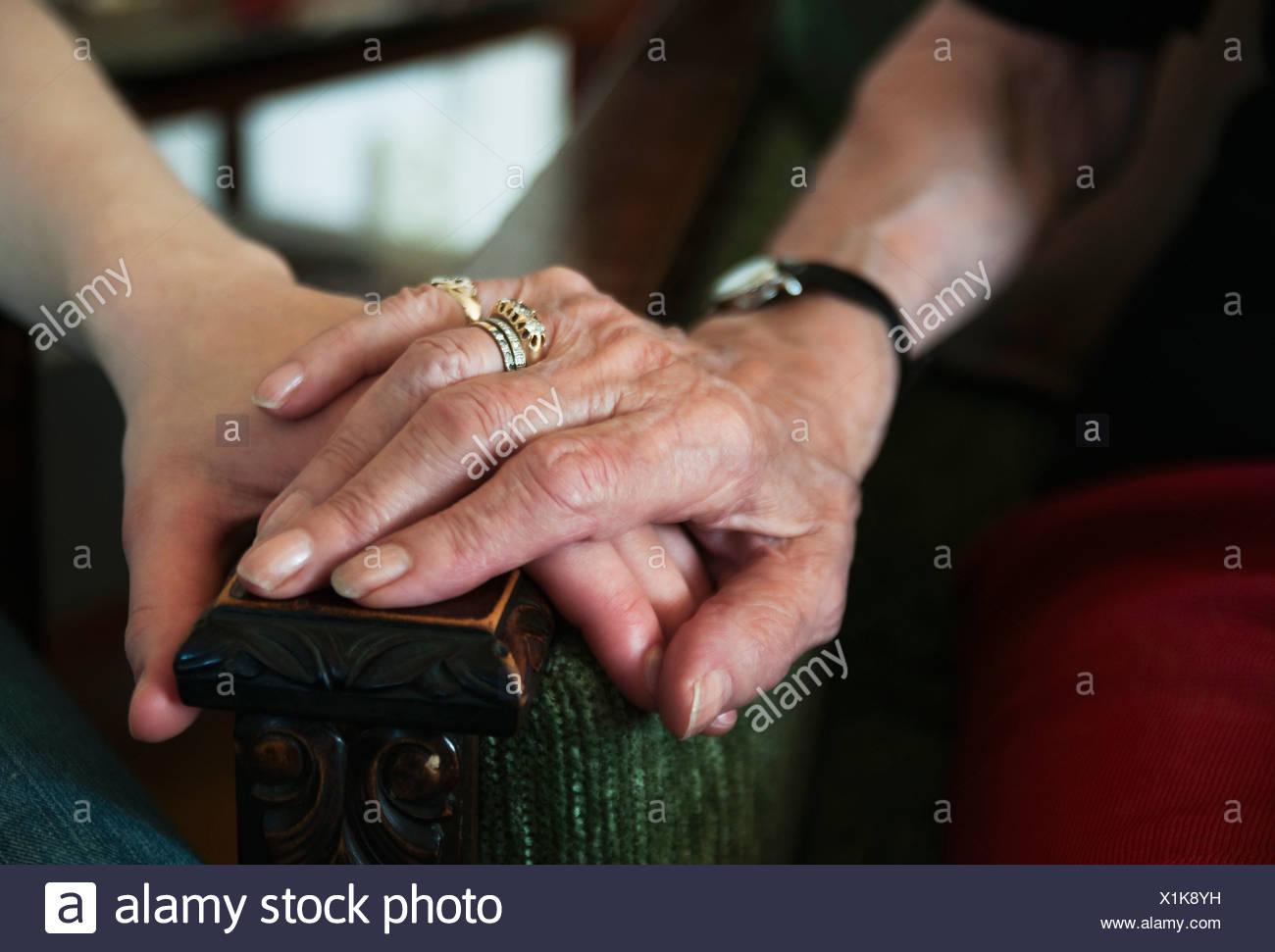 Hands on armrest - Stock Image