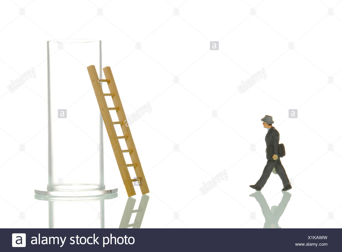 Manager figurines and glass with ladder, symbolic image for 'Back in the everyday' - Stock Image