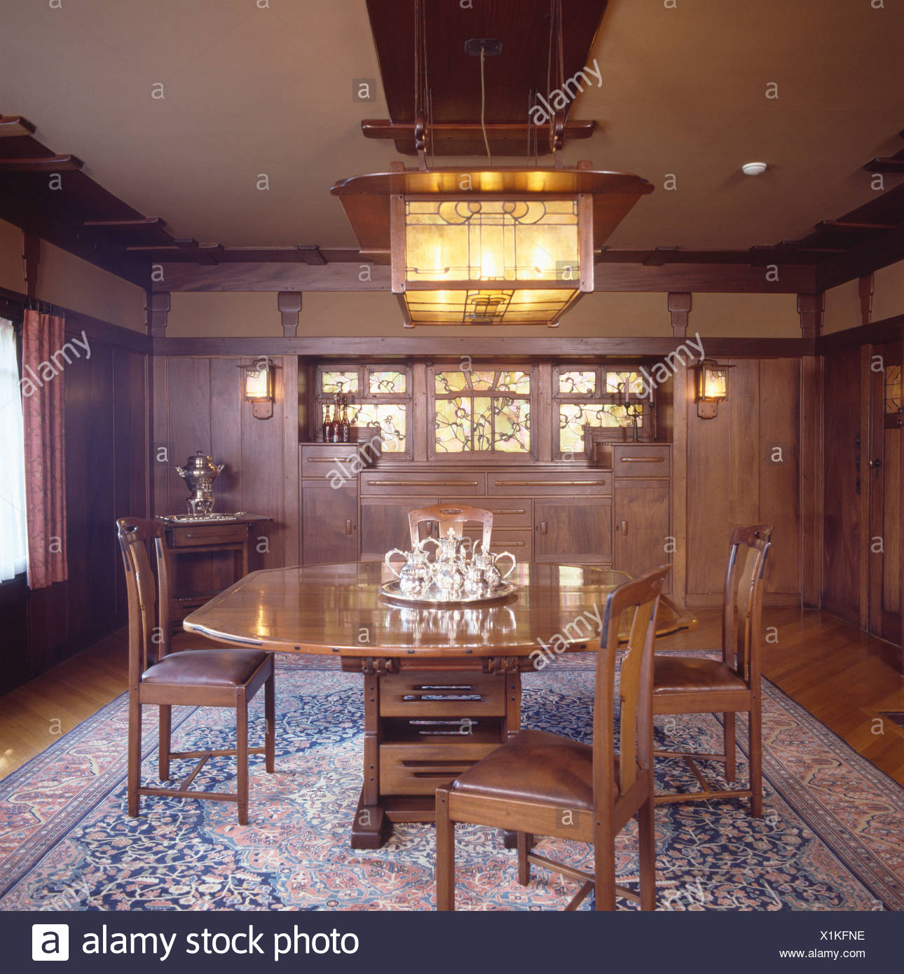 Arts And Crafts Light Above Wooden Table And Chairs In Paneled Dining Room  In The Gamble House Designed By Greene And Greene