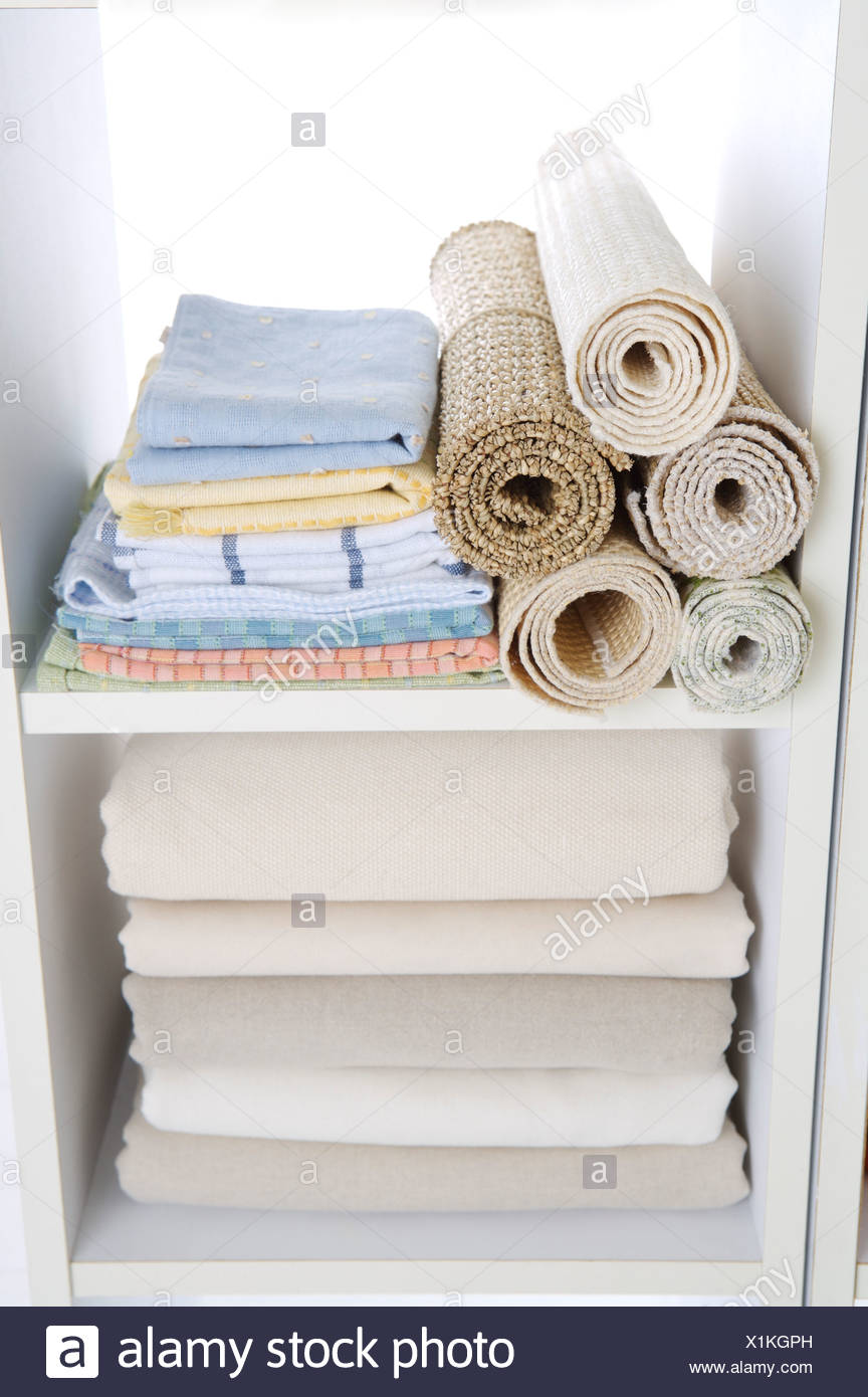 Clothes Rugs Stocked In A Closet Stock Photo 276410809 Alamy