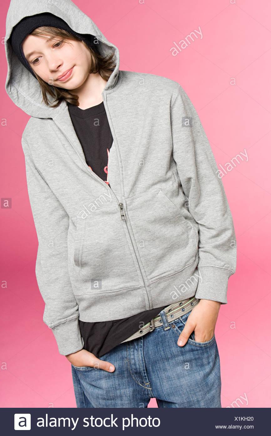 Teenage boy thinking - Stock Image