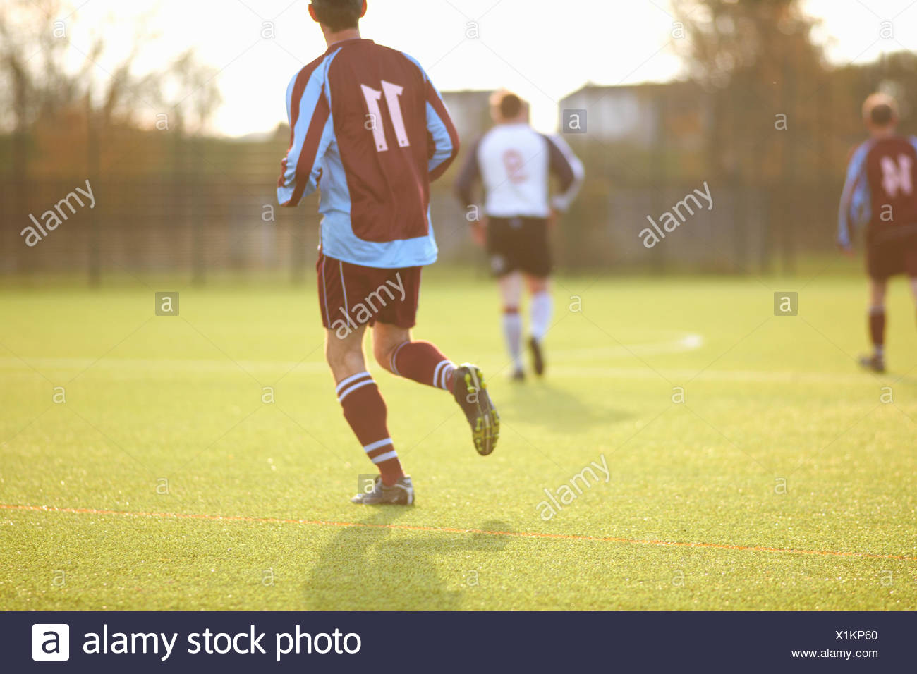 Football players during game - Stock Image