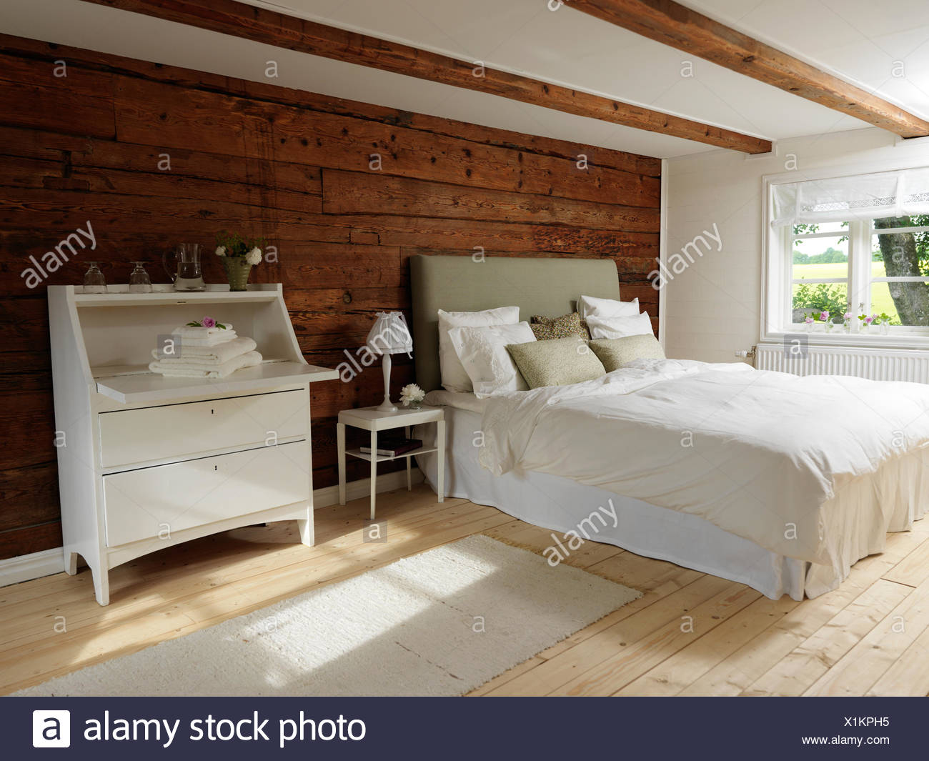 Sweden, Scandinavian style bedroom with wood and white color theme - Stock Image