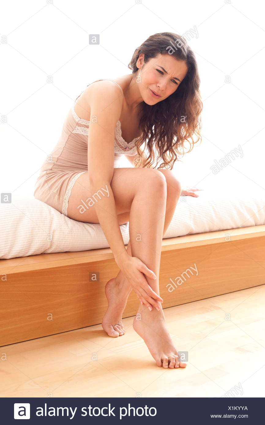 Woman with a sore ankle - Stock Image