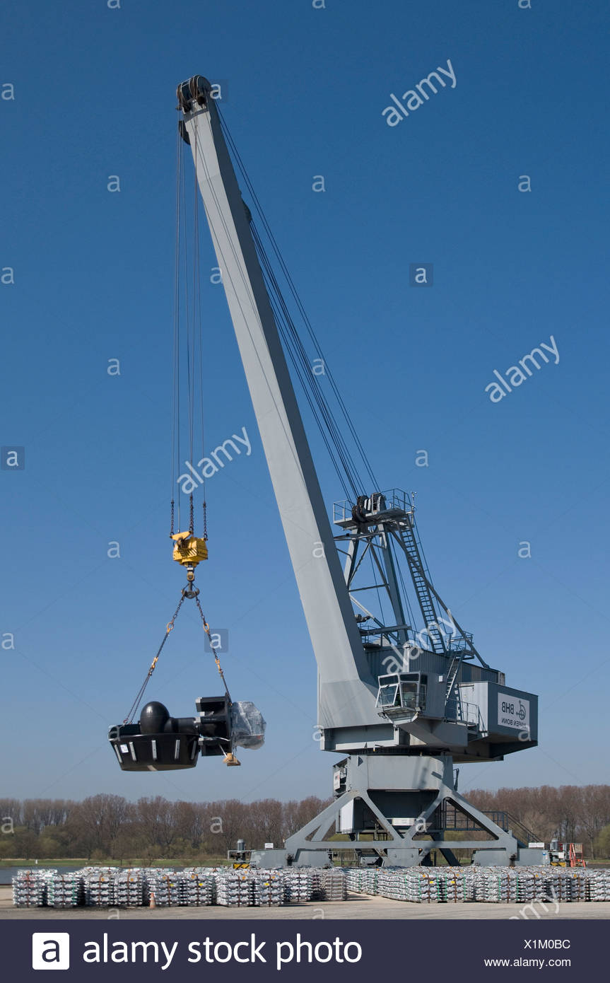 Bonn harbor, crane loading parts of a turbine engine, in front aluminum ingots ready for pick-up, Bonn, North Rhine-Westphalia, - Stock Image