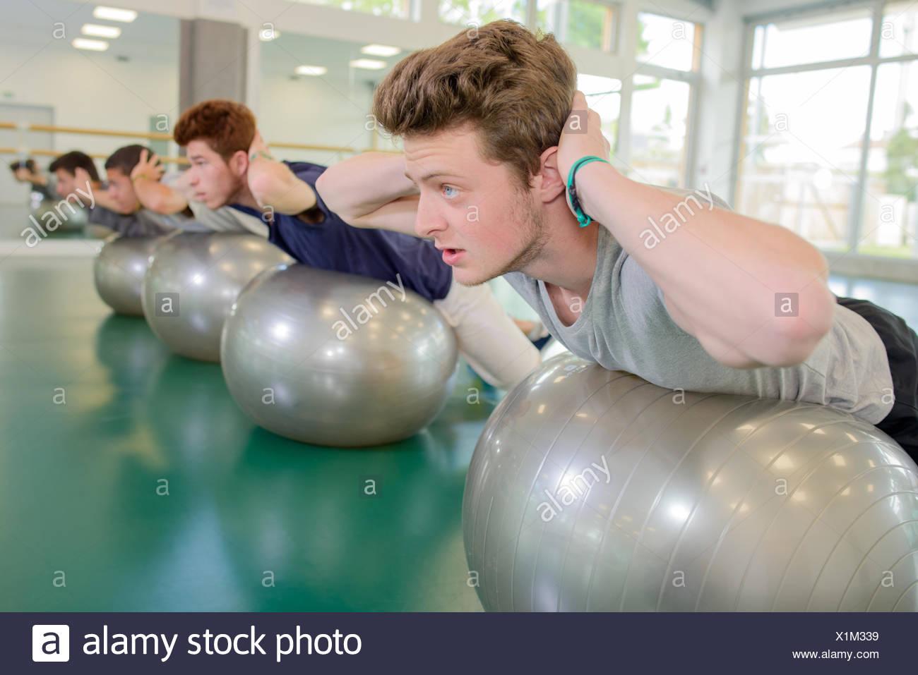 men on their gym ball - Stock Image