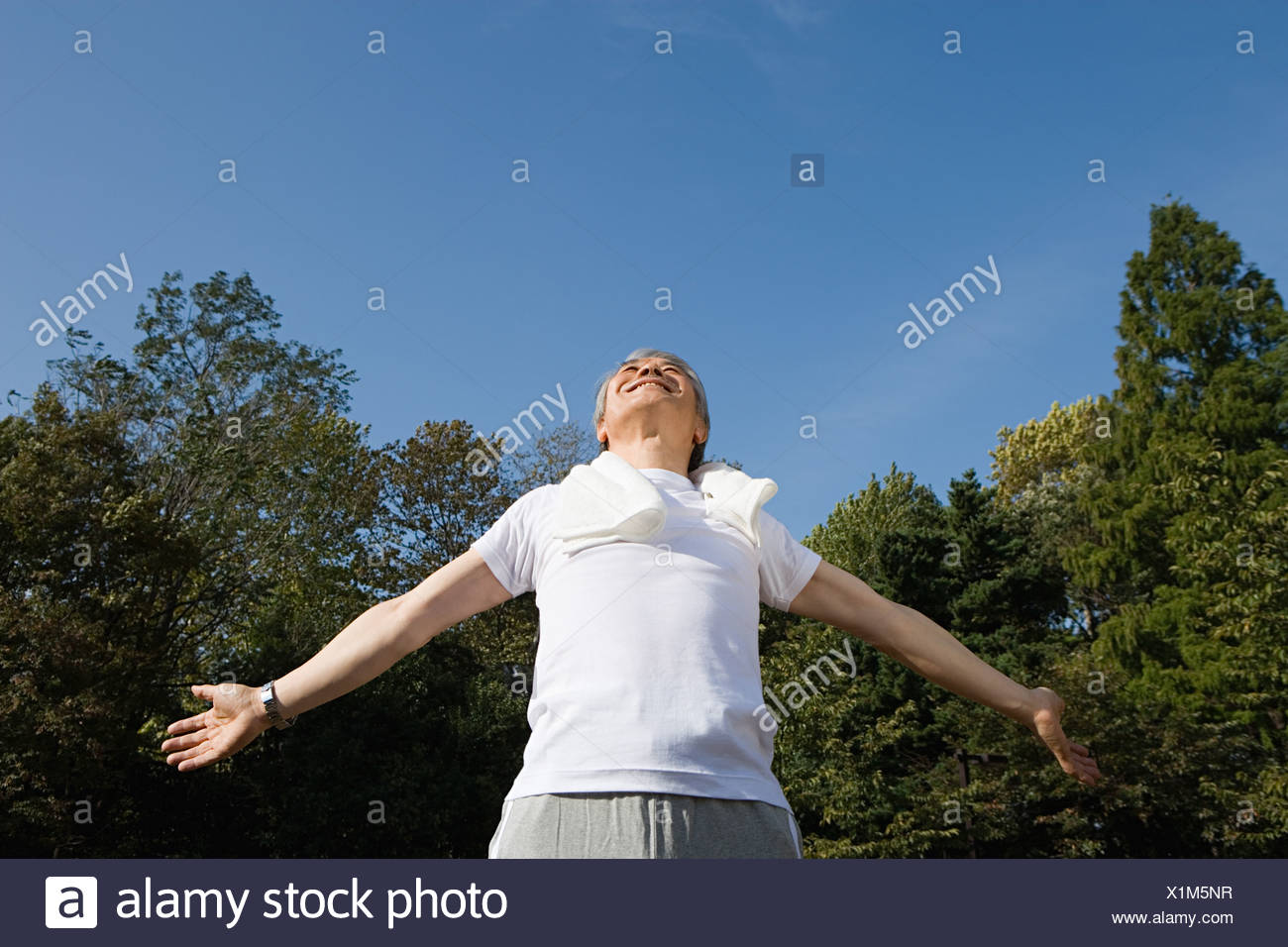 Man with arms open - Stock Image