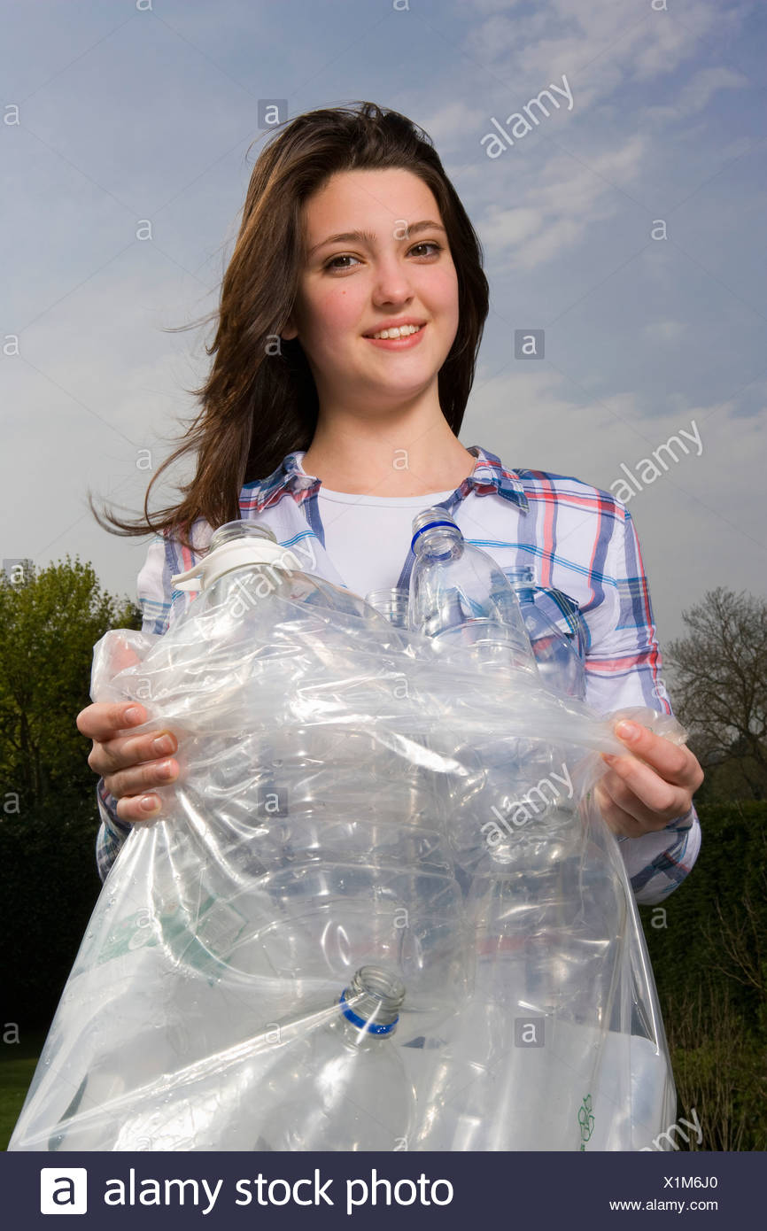 Girl 14, recycling - Stock Image