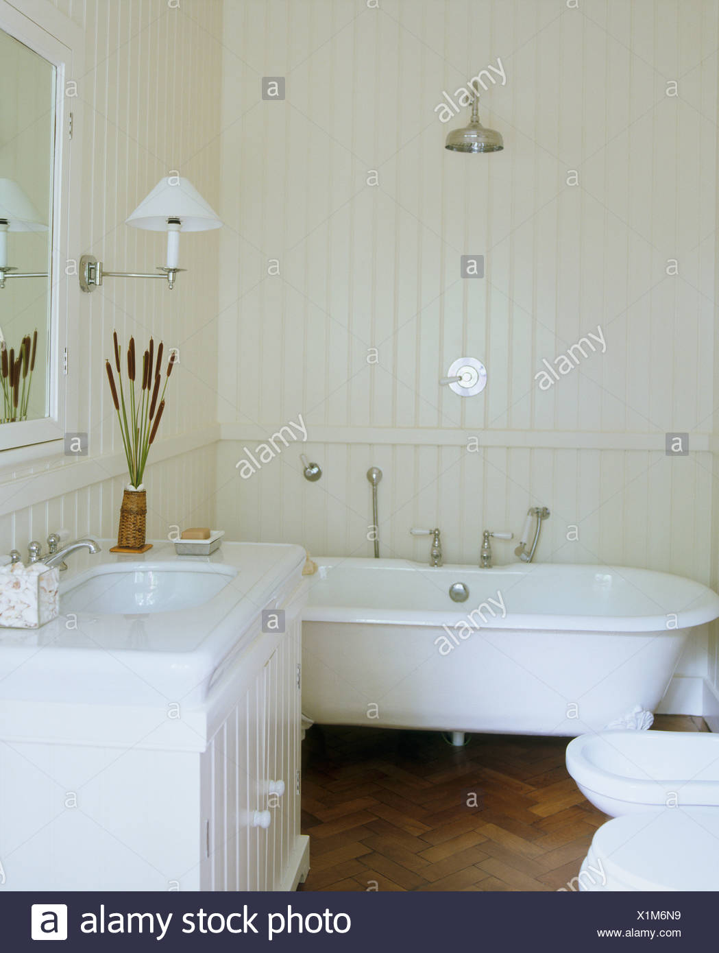 Chrome Shower Above Roll Top Bath In White Bathroom With ...