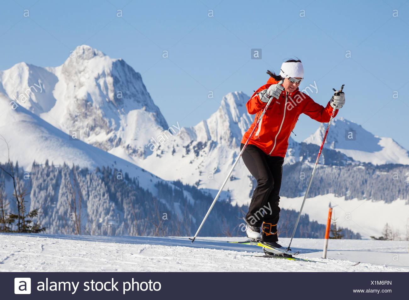 Woman cross-country skiing, Gantrisch area, Berner Oberland, Canton of Bern, Switzerland - Stock Image
