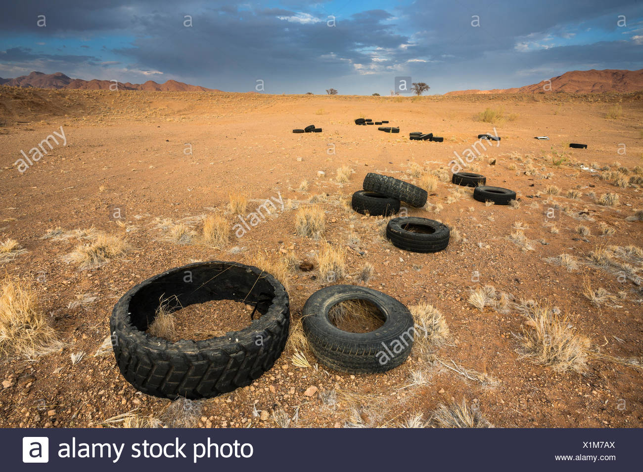 Pollution in the Namib Desert, due to illegal dumping of old tires. Namibia. - Stock Image