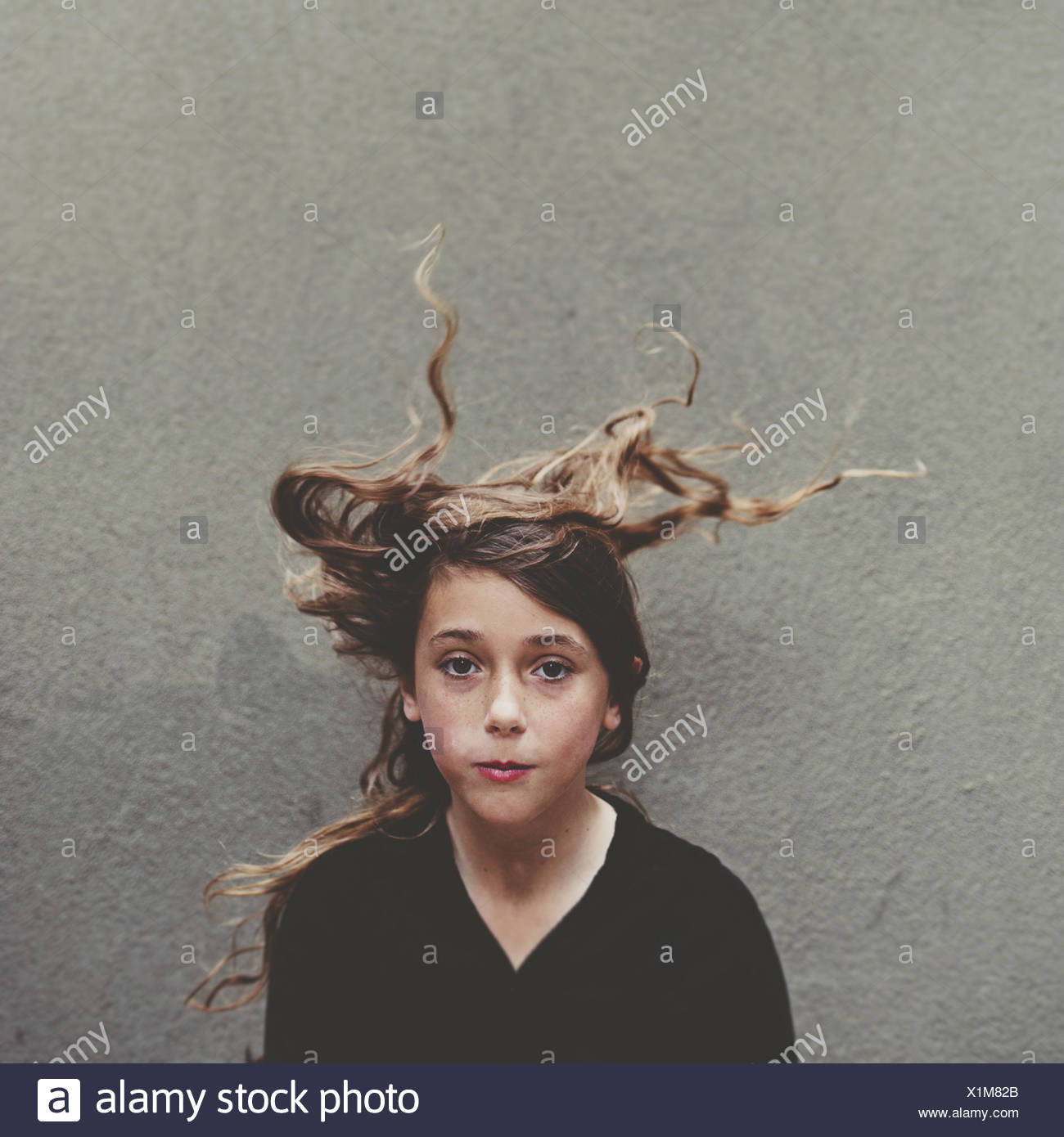 Portrait of a girl with windswept hair - Stock Image