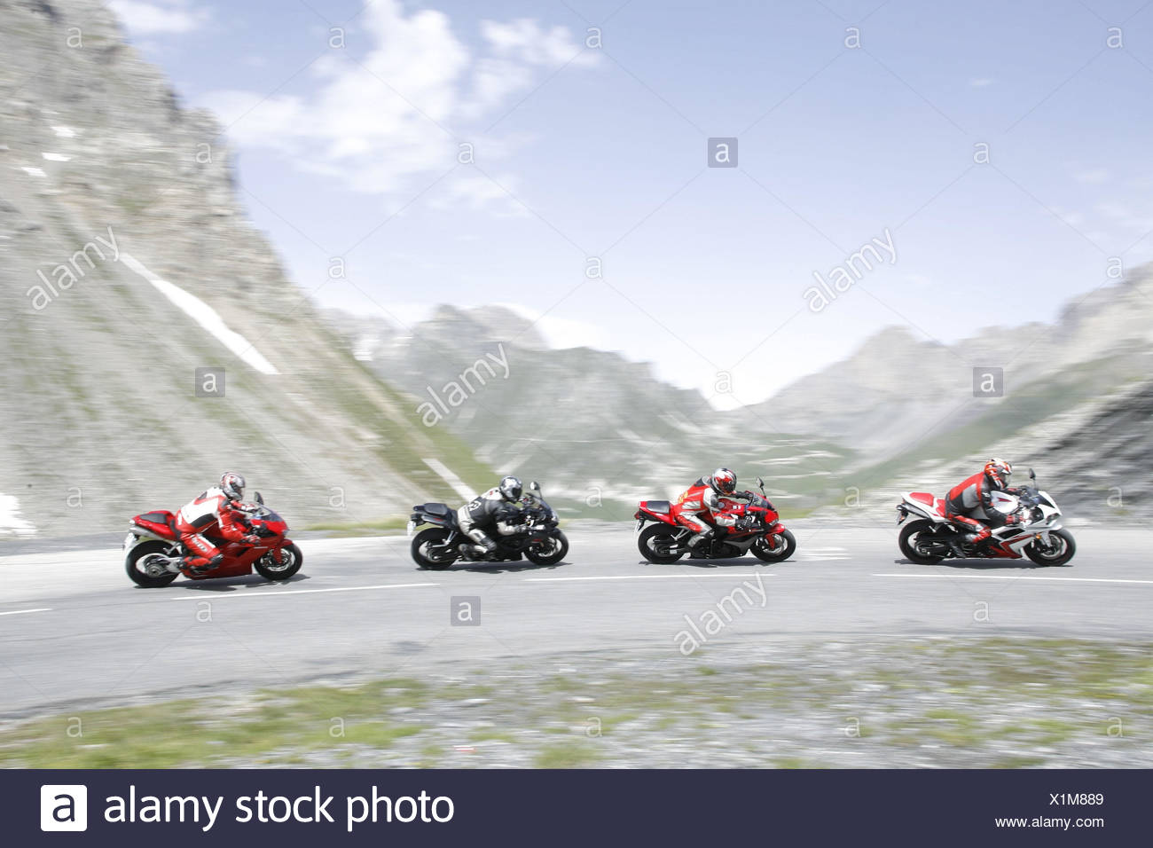 Motorcycles, 4th formation, alp scenery - Stock Image