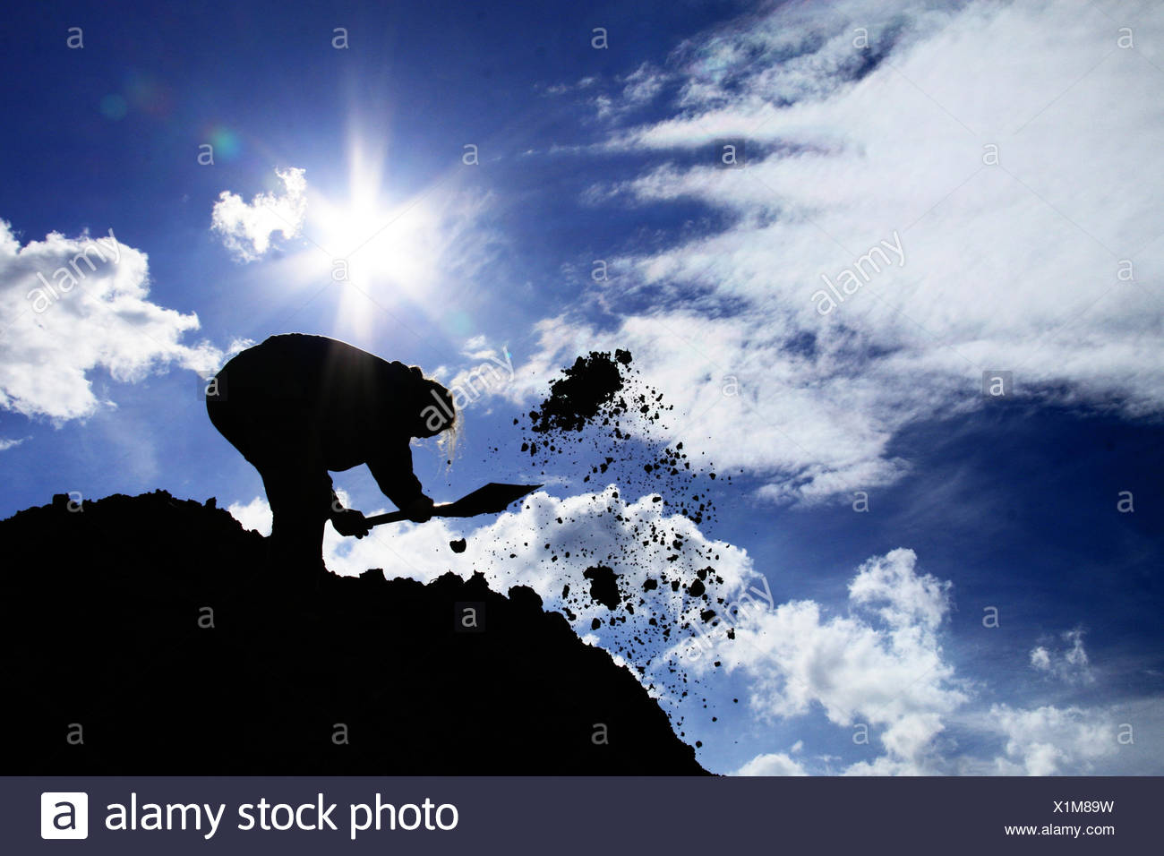silhouette,digging,excavation - Stock Image