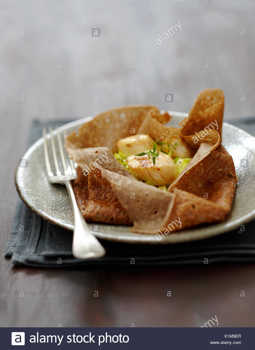 Scallop and leek pancake purse - Stock Image