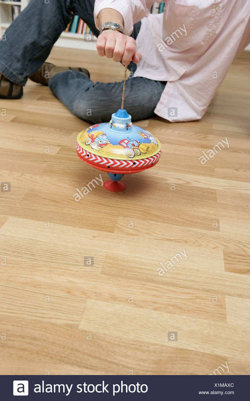 Man playing with a humming-top - Stock Image